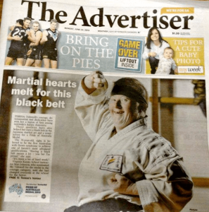 Advertiser paper image of Teresa on front cover when she gained her black belt